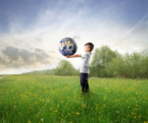 shutterstock_61051801_Child holding Earth on green meadow_copyright  olly copy